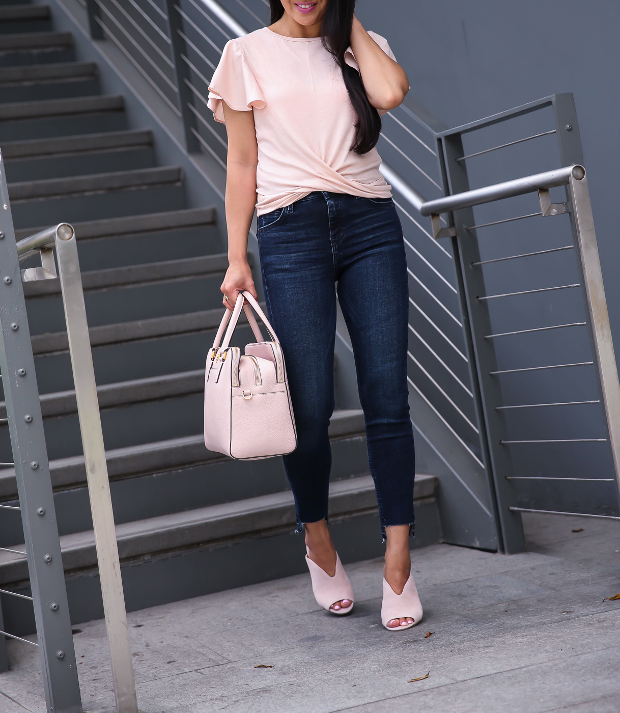 step hem jeans twist front ruffle sleeve tee pink mules casual outfit