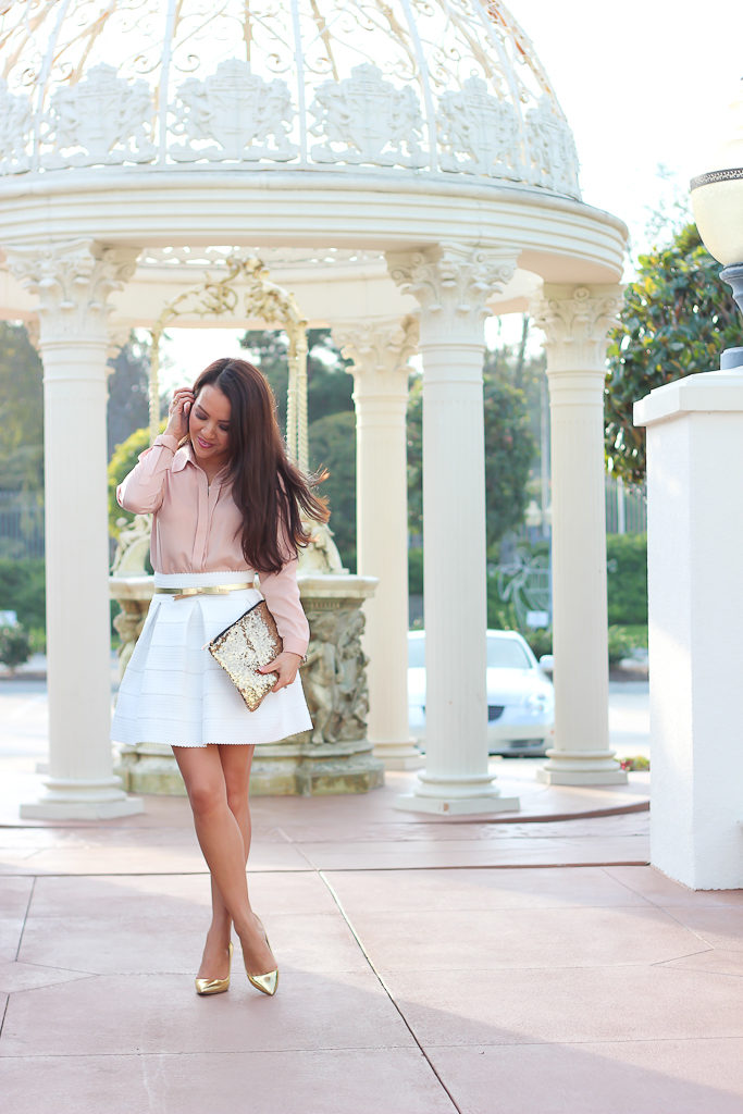 Ann Taylor blush nude blouse, gabriella rocha sophey skirt, gold bow belt, J.Crew gold everly pumps, sequin clutch purse, white cabochon necklace, white flare skirt