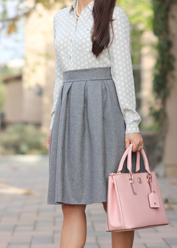 grey pleated skirt Tory Burch mini Robinson purse Christian Louboutin pigalle pumps Loft polka dot blouse
