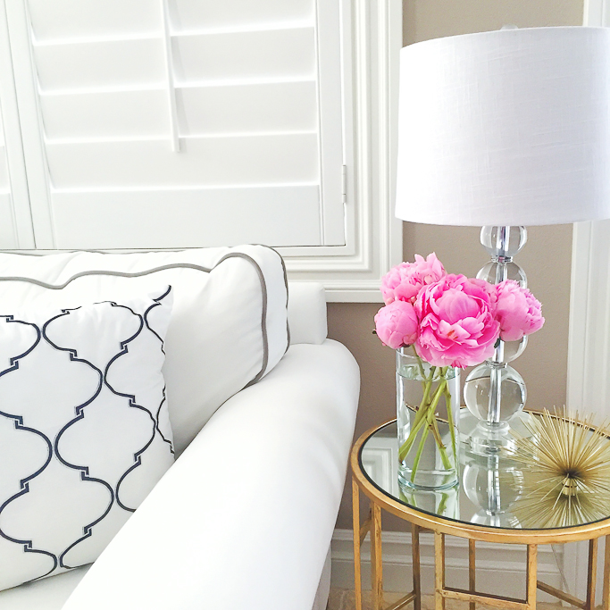 crystal table lamp, Gold End table, Graphic pillows, LuLu & Georgia gold urchin, pink peeonies, Pottery Barn sofa