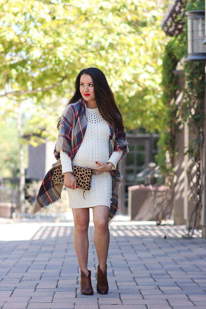 6 ways to wear a plaid blanket scarf, Clare V leopard foldover clutch, Fall outfit, Loft cognac bow belt, Mac ruby woo red lipstick, Nordstrom cable knit sweater drses, Petite maternity outfits p, plaid blanket scarf, Vince Camuto franell western ankle booties