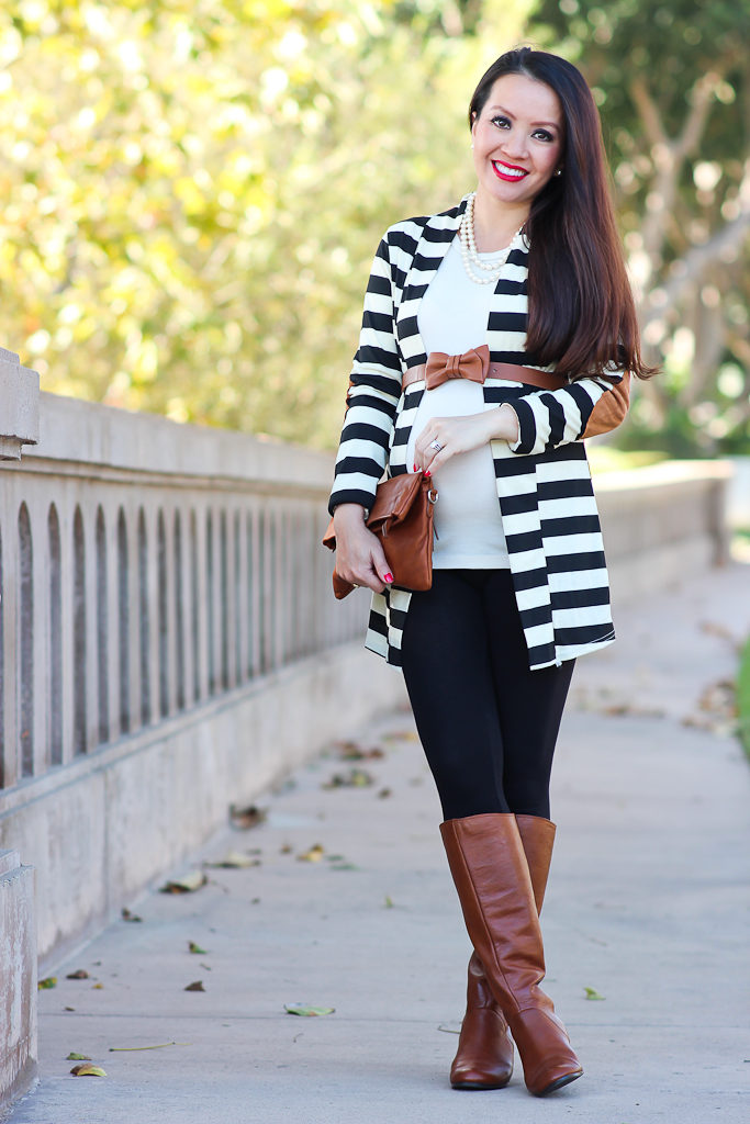 black leggings with brown boots, BP cognac riding boots, Fall outfit, Italian cognac foldover clutch, Loft coganc bow belt, Petite maternity outfits, petite pregnant clothes, Striped elbow patch cardigan