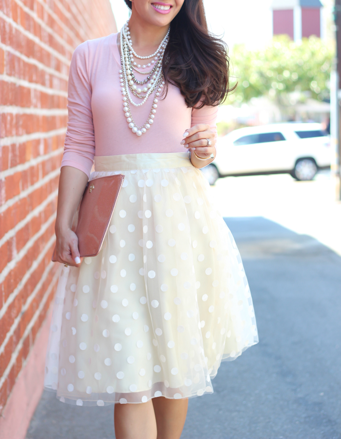Space 46 Boutique polka dot tulle skirt JCrew blush tee Ann Taylor pearlizled crystal statement necklace Kate Spade glitter bug clutch