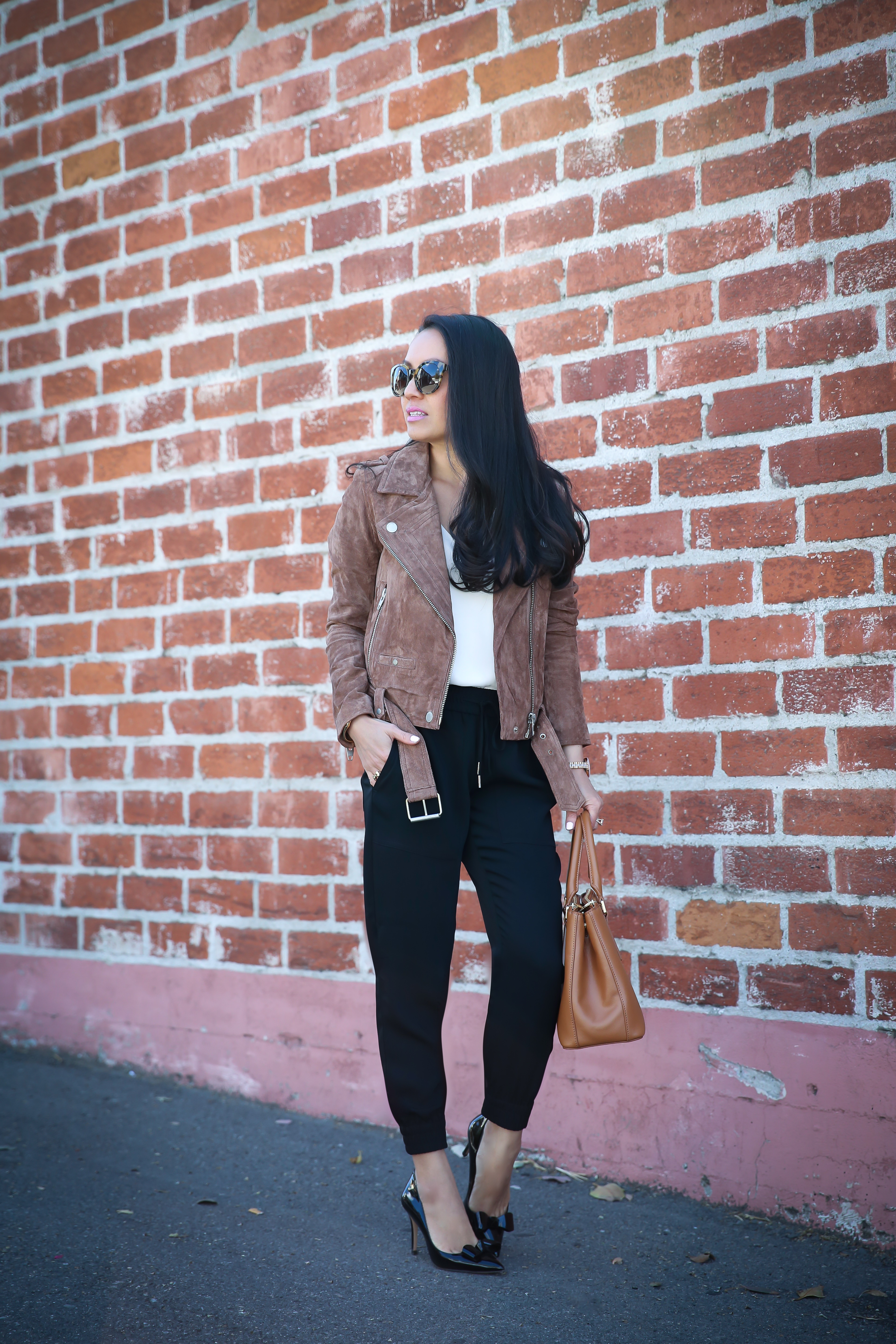 jogger pants suede moto jacket bow pumps chic work outfit