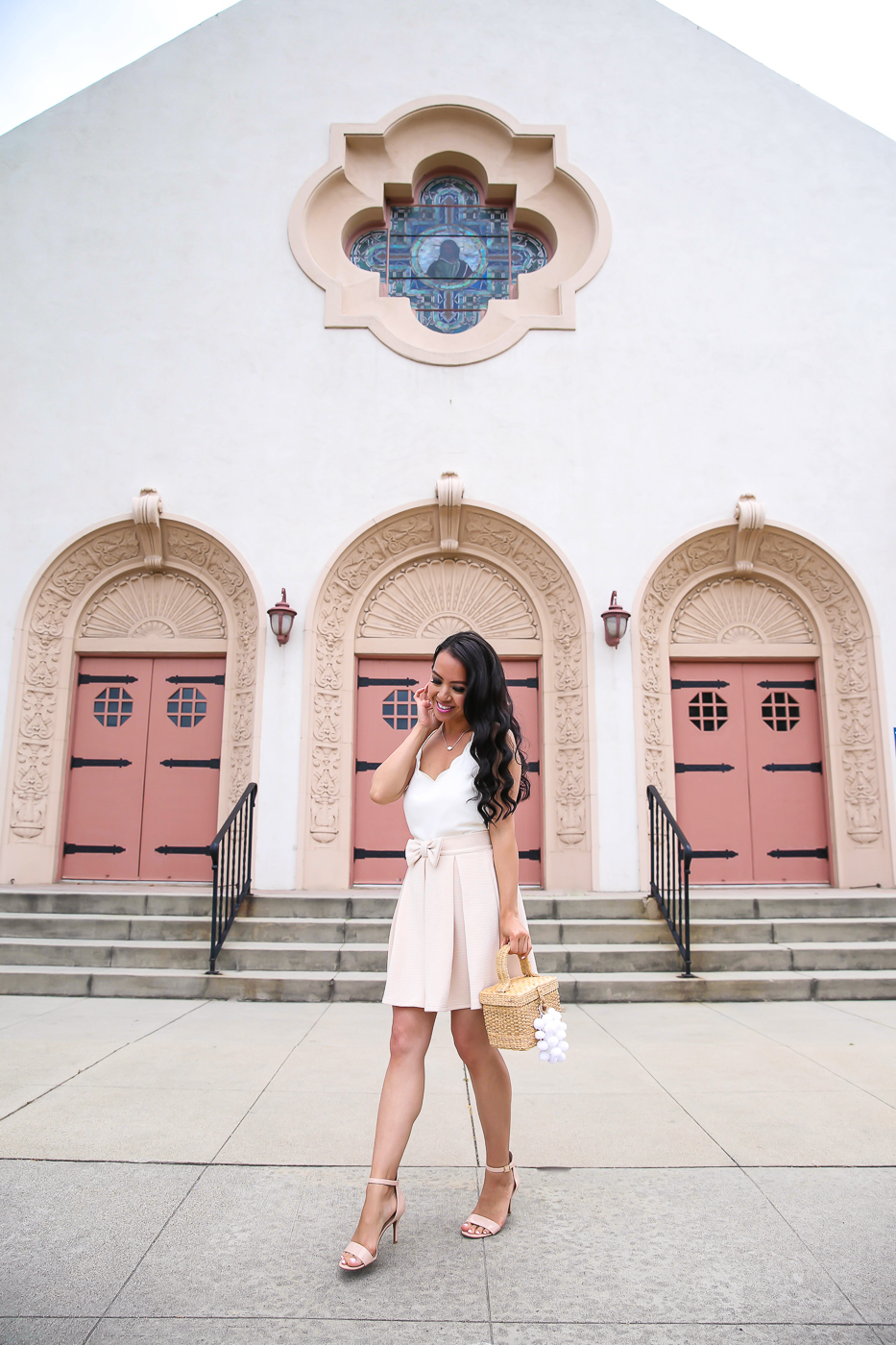 pleated bow skirt scalloped cami straw bag summer outfit idea