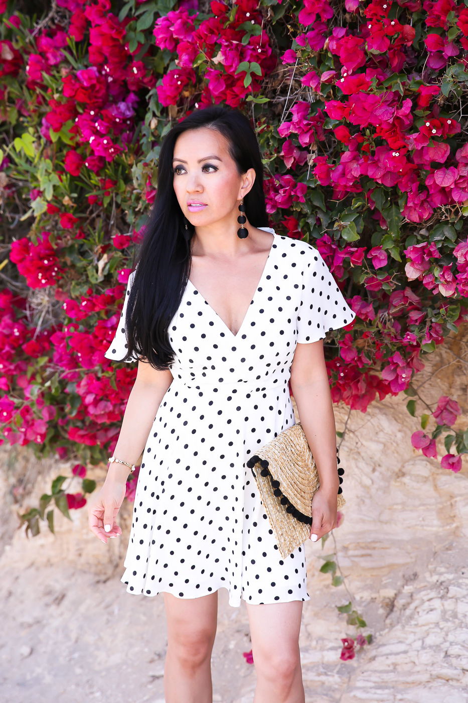 polka dot flutter sleeve fit and flare dress pom trim straw clutch summer outfit