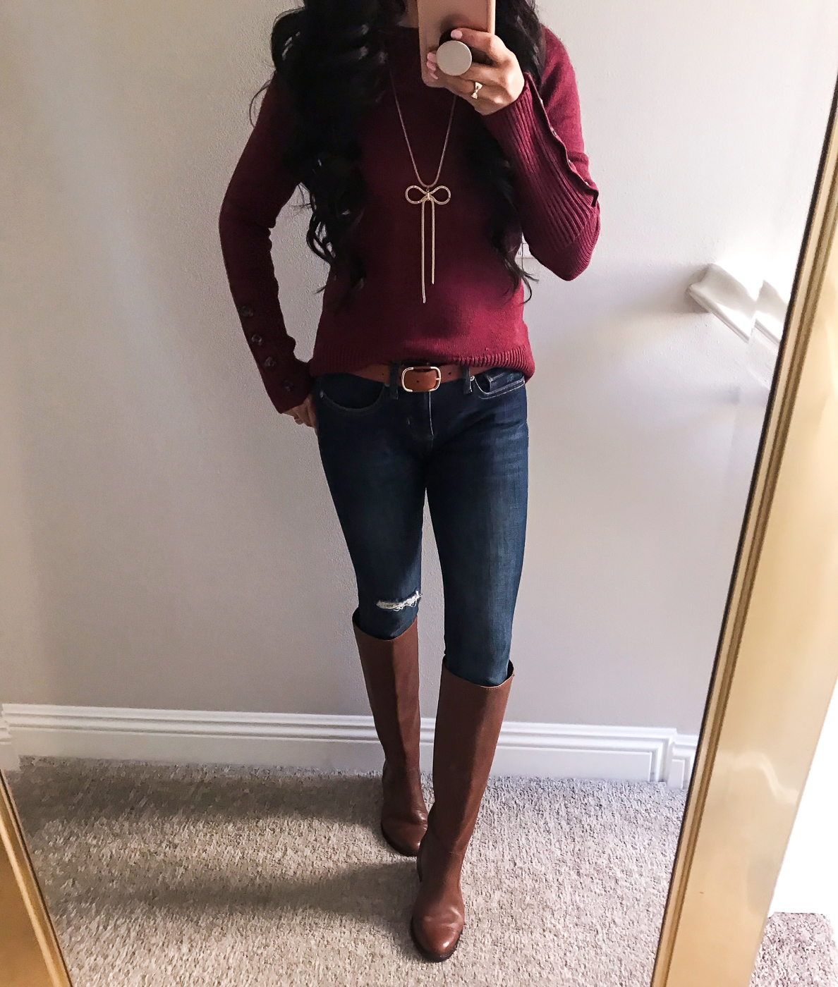 burgundy sweater bow necklace skinny jeans cognac riding boots fall outfit