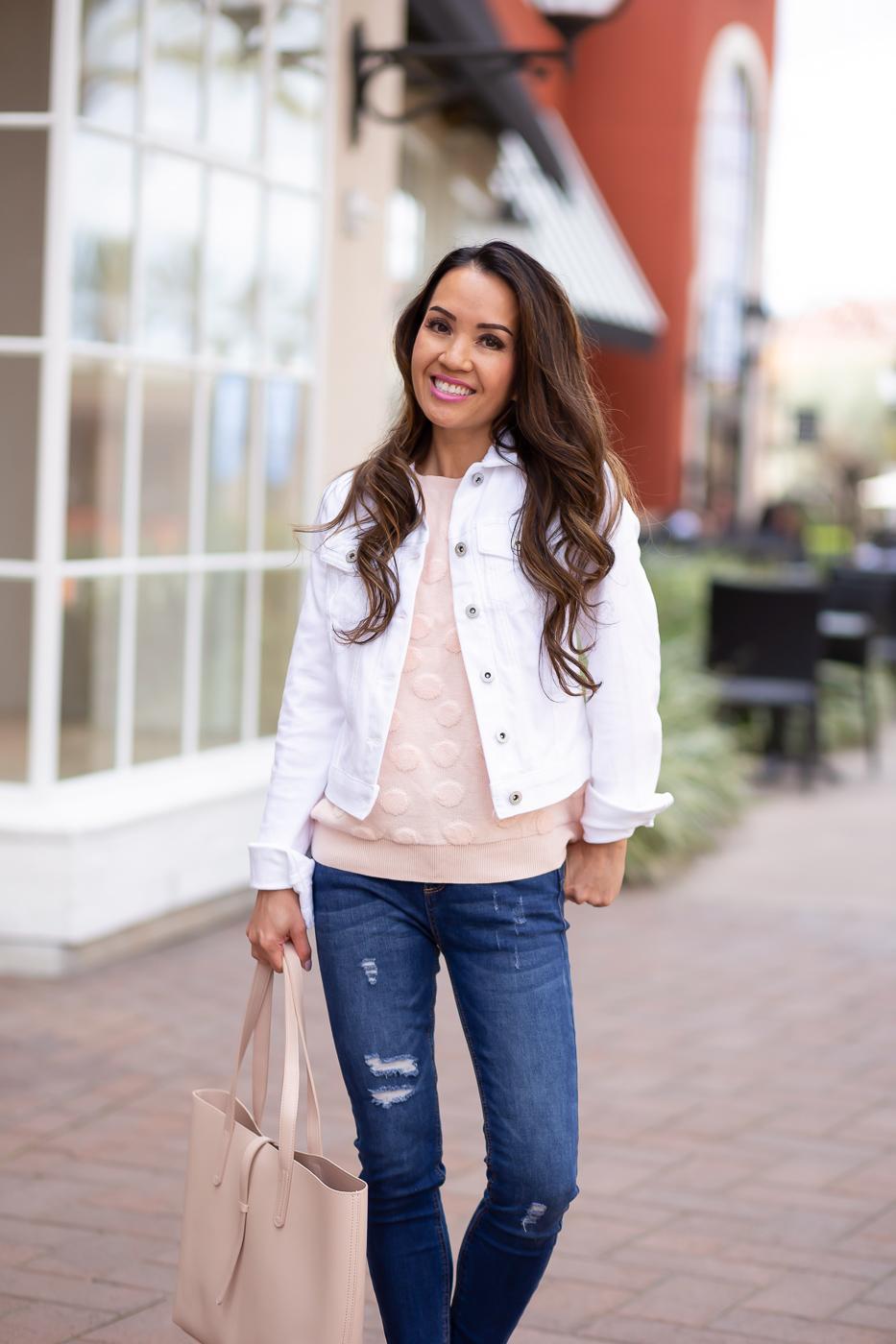 white denim jacket blush tote cognac espadrilles spring outfit distressed denim pink sweater
