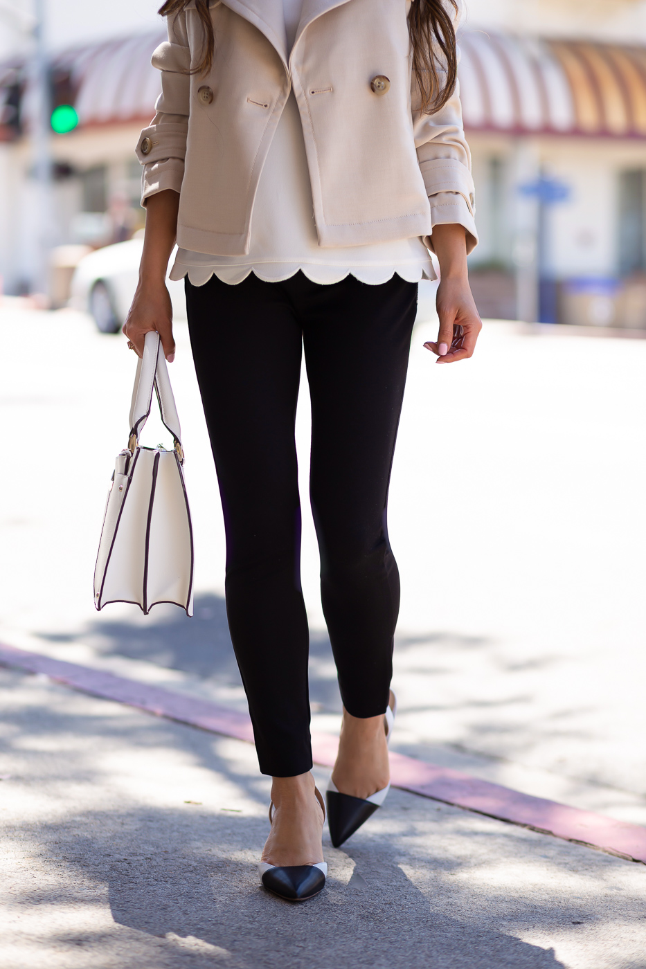 short trench coat scalloped shell black pants colorblock slingback pumps