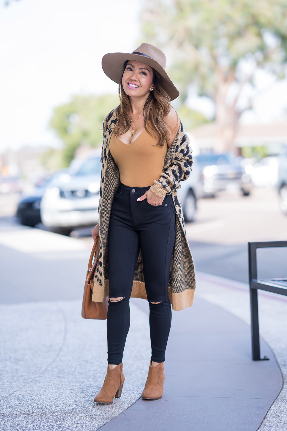 leopard cardigan black distressed high waisted jeans camel hat ankle booties